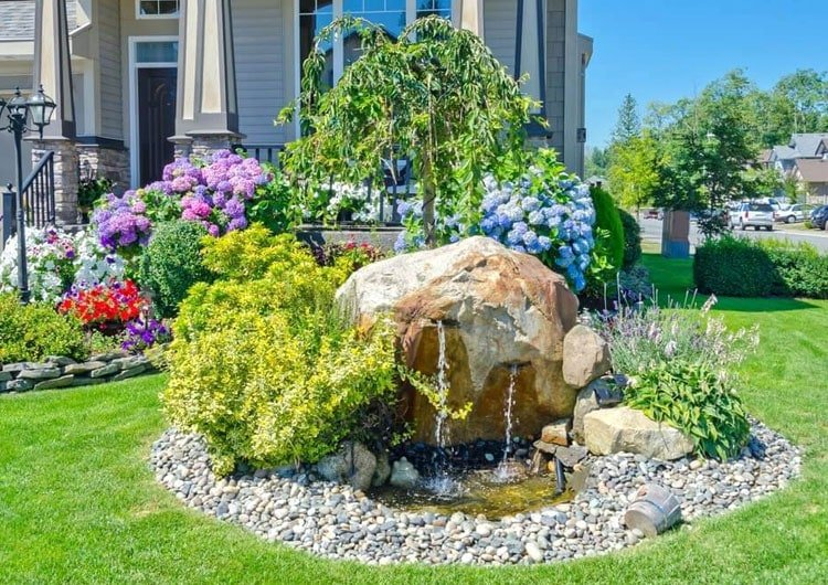 Beautiful Flower Bed with Small Waterfall