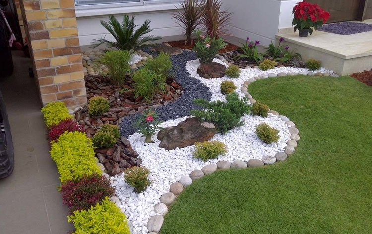 White Rocks with Stone Edging For Plant Bed in Front of House