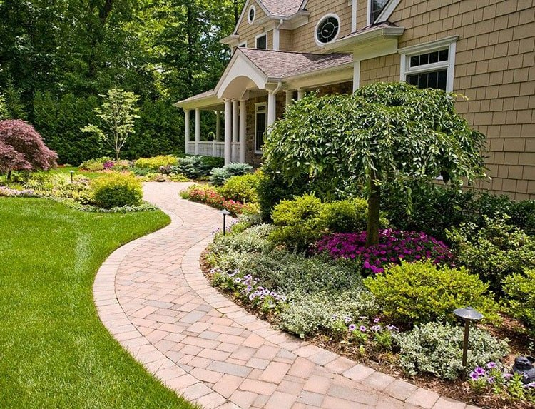 Clean Front Yard Landscape That Lines The Walkway