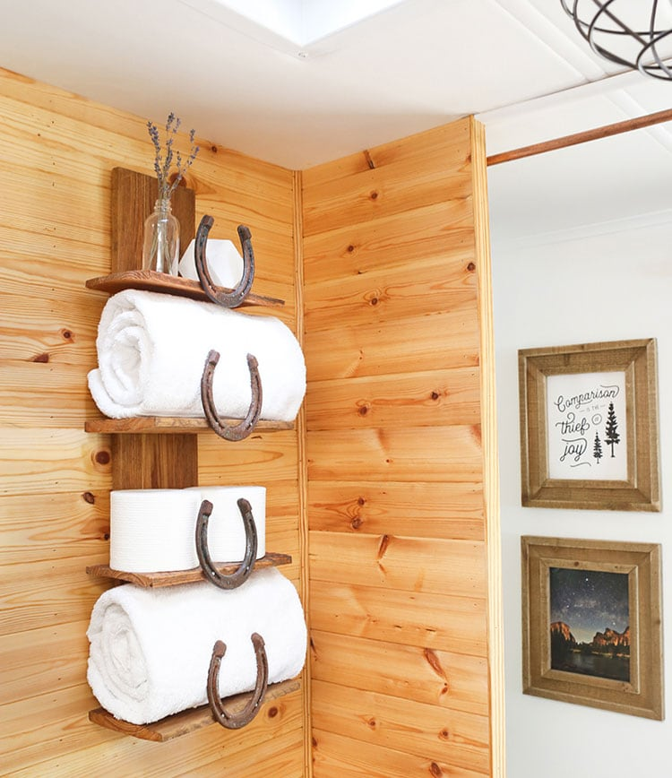 DIY Rustic Ideas Horseshoe Shelves with Light Wood Wall Paneling