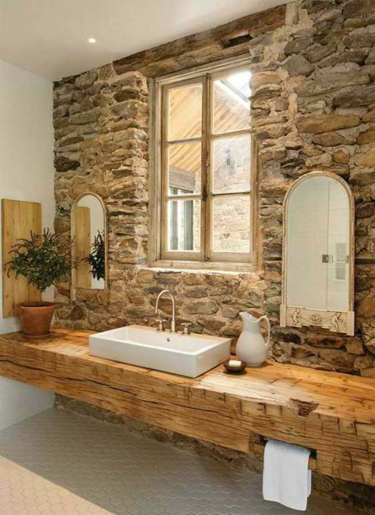 Rustic Country-Themed Bathroom with Stone Wall and Wood Counter
