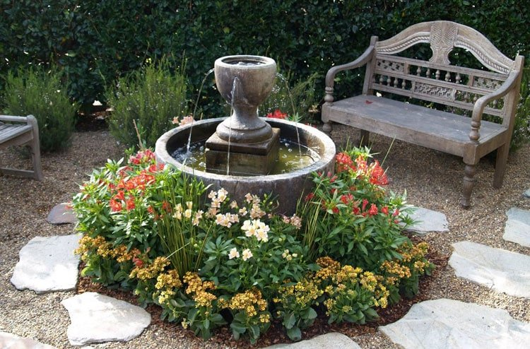 Simple Front Yard Fountain with Wood Chair and Beautiful Flowers