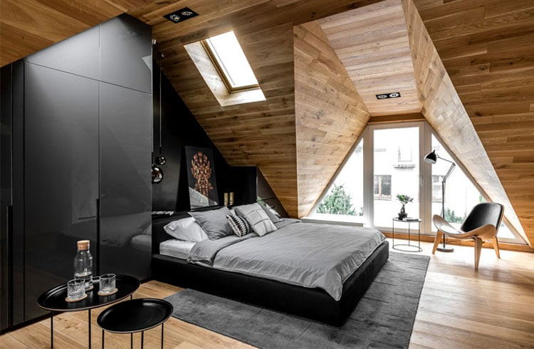 Stylish Bedroom with Black Styling and Light-Colored Wooden Walls