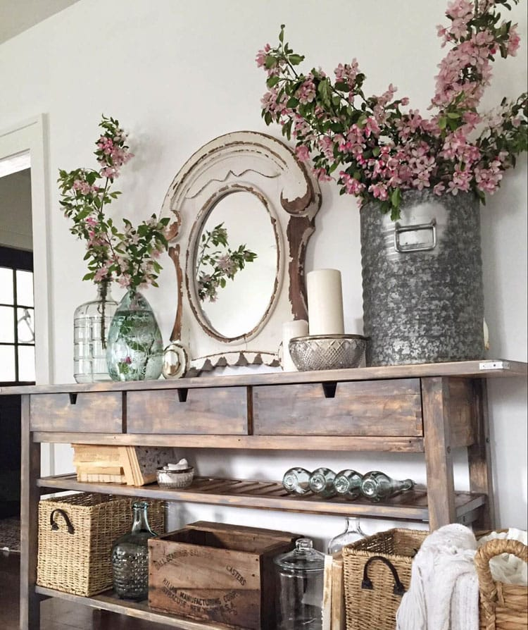 Farmhouse Console Table Decor with Lush Plants and Baskets