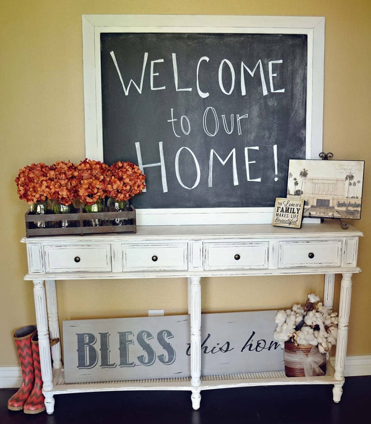 Whimsical White Foyer Table with Welcome Chalkboard Sign