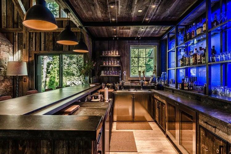 Cool Basement Bar with Custom Lighting and Shelves