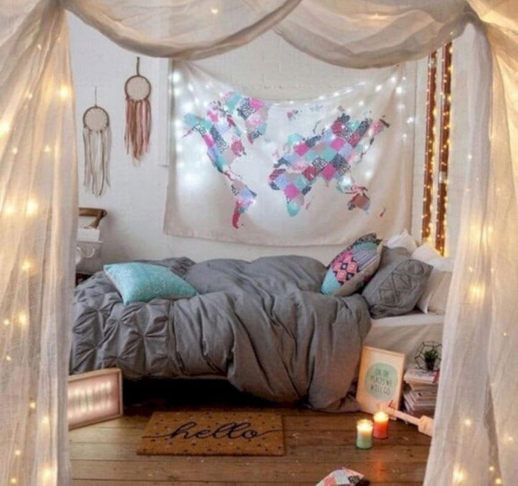 Cozy Bohemian Bedroom with Colorful Tapestry and Unique Lighting Features