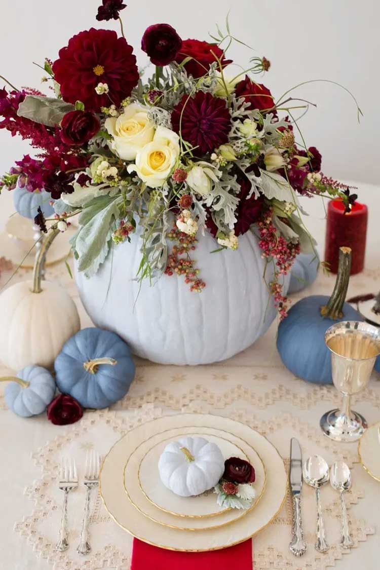 Blue Pumpkins With Fall Flowers in White Vase