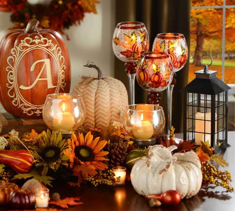 Etched Pumpkin Centerpiece with Candles and Flowers