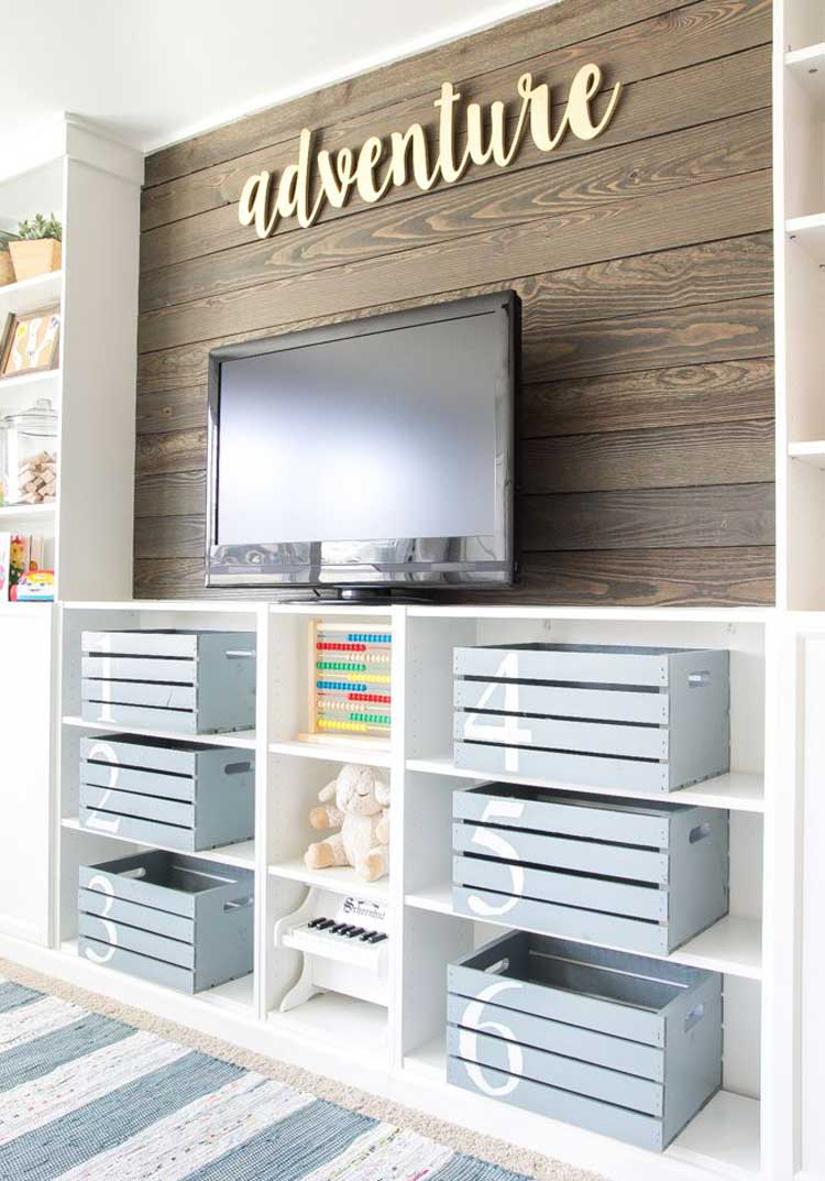 Built-In Shelving with Painted Wooden Crates In Game Room