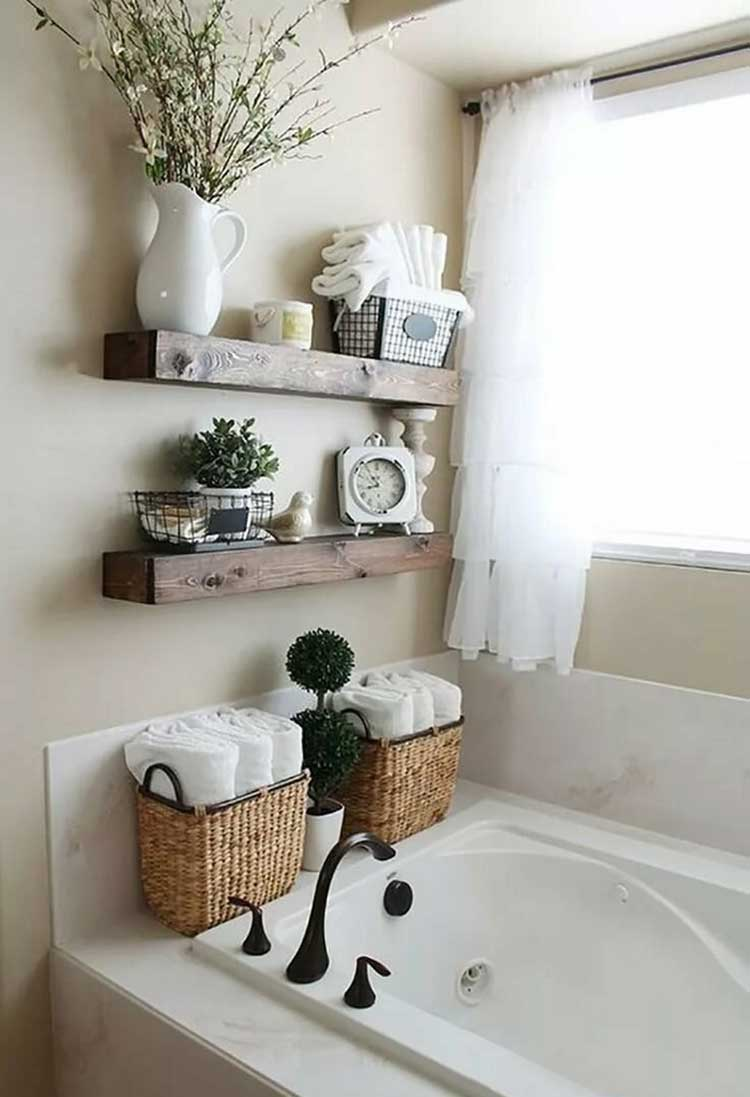 Small Floating Shelves Over Bathtub Provide Discreet Storage