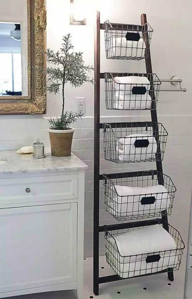 Storing Towels in Baskets on Ladder