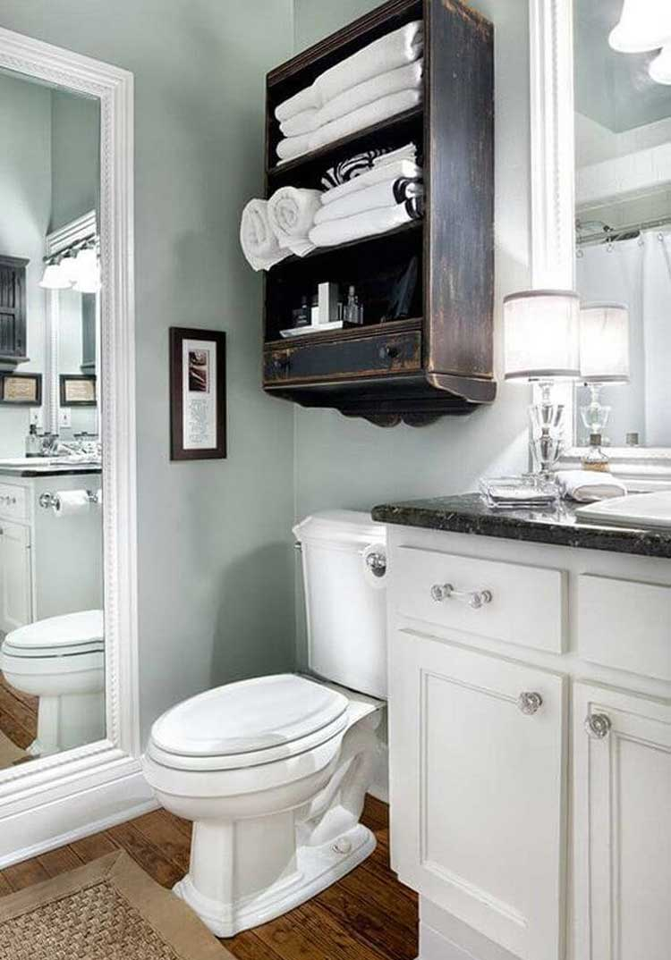 Use Antique Pieces Above The Toilet For Organization